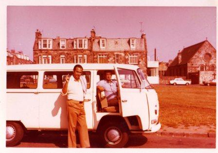 my parents with our first campervan